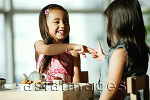 Asia Images Group - Two girls at tea party, playing
