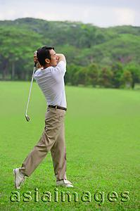 Asia Images Group - Golfer playing golf