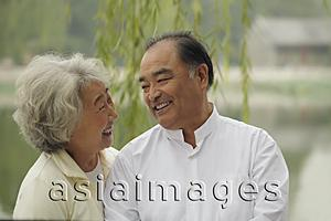 Asia Images Group - Head shot of older couple looking at each other and smiling.