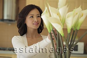 Asia Images Group - Young woman arranging flowers